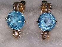 Золотые сережки с голубым топазом